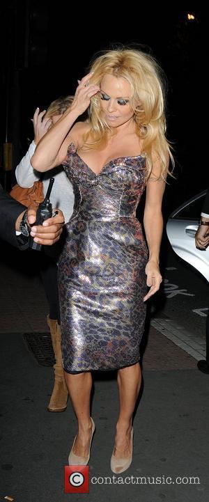 Pamela Anderson leaving Spearmint Rhino Gentlemen's Club. London, England - 15.09.11