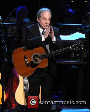 Paul Simon Helps Oprah Winfrey Bring Talk Show To Emotional End