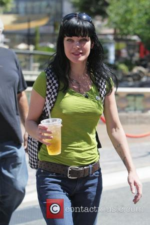 Pauley Perrette makes an appearance on 'Extra' with Mario Lopez at The Grove in Hollywood Los Angeles, California - 08.09.11