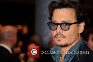 Depp Shares Pirates Premiere Red Carpet With Schoolgirl