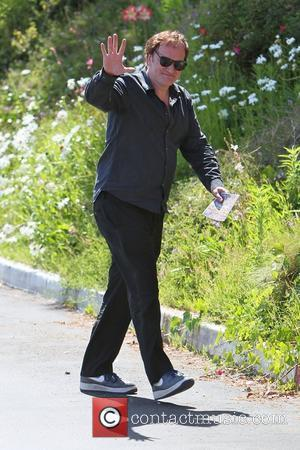 Quentin Tarantino goes to Cafe Med restaurant on Sunset Plaza. When leaving, Quentin is seen holding a brochure for a...