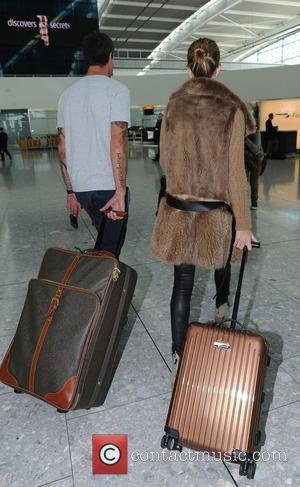 Rosie Huntington-Whiteley arriving at Heathrow Airport London, England - 21.09.11