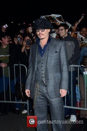 Unsteady Johnny Depp Needs Helping Hand At Film Premiere