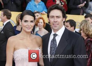 Angie Harmon and Jason Sehorn