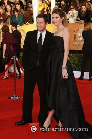 Mark Wahlberg and Wife The 17th Annual Screen Actors Guild Awards (SAG Awards 2011) held at the Shrine Auditorium &...