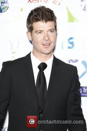 Robin Thicke,  at the 2011 Silver Rose gala and auction at Beverly Hills Hotel. Beverly Hills, California - 17.04.11