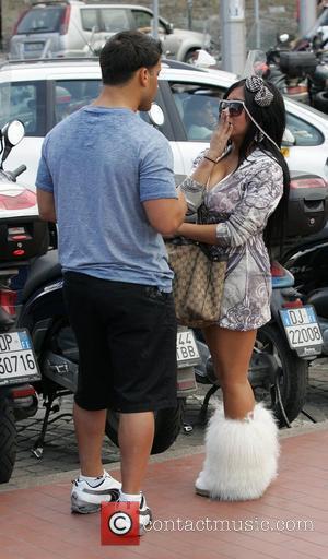 Jionni LaValle Nicole Polizzi aka Snooki Nicole Polizzi aka Snooki filming with her boyfriend for MTV's 'Jersey Shore'. Snooki is...