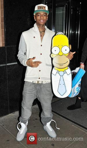 Soulja Boy arrives at his midtown hotel with a Homer Simpson skateboard New York City, USA - 31.10.11