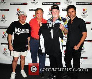 Bruce Johnston, owner of the Florida Marlins Jeffery Loria, Mike Love and John Stamos The Beach Boys with special guest...