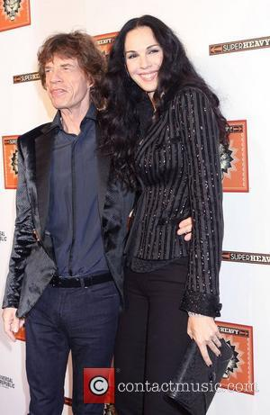 Mick Jagger and L 'Wren Scott  Members of Sir Mick Jagger's new supergroup Superheavy celebrate the release of their...