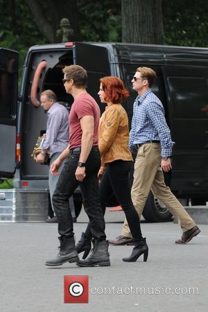 Scarlett Johansson,Jeremy Renner, Chris Evans,  on the film set of 'The Avengers', shooting on location in Manhattan New York...