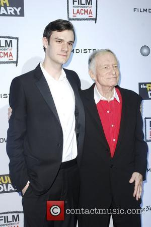Hugh Hefner, son,  at 'The Rum Diary' premiere held at the LACMA Bing Theater - Arrivals Los Angeles, California...