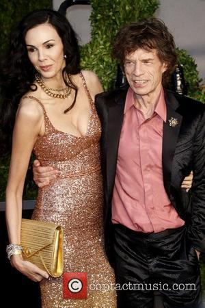 L'Wren Scott and Mick Jagger 2011 Vanity Fair Oscar Party at Sunset Tower Hotel - Arrivals West Hollywood, California -...