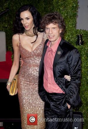 L'Wren Scott and Mick Jagger 2011 Vanity Fair Oscar Party at Sunset Tower Hotel - Arrivals  West Hollywood, California...