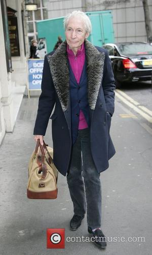 Rolling Stones drummer Charlie Watts walking in London's West End London, England - 09.03.11