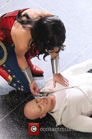 Adrianne Palicki films a scene for 'Wonder Woman' where she apprehends a criminal before injecting him in the neck with...