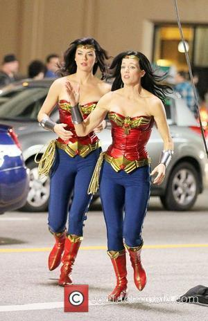 Adrianne Palicki (L) and her stunt double filming on the set of 'Wonder Woman' Los Angeles, California - 30.03.11