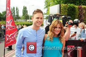 Olly Murs and Caroline Flack arrive at the LG Arena Birmingham for the first round auditions of the 2011 X...