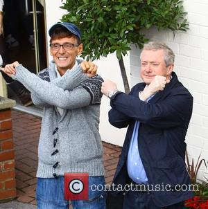 X Factor finalist Johnny Robinson with Louis Walsh arriving at rehearsals London, England - 04.11.11