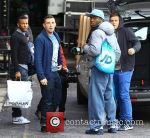 X Factor finalists Ashford Campbell, Charlie Healy, Derry Mensah and Andrew Merry of The Risk arriving at rehearsals London, England...