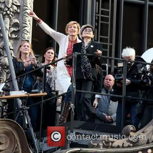 Annie Balliro and Yoko Ono on top of the Hard Rock Cafe marquee as they launch the 'Imagine There's No...