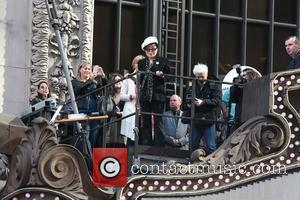 Yoko Ono on top of the Hard Rock Cafe marquee for the launch the 'Imagine There's No Hunger' campaign at...
