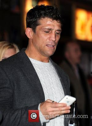 Alex Reid receives a text message  UK premiere of 'Zebra Crossing' at the Empire Leicester Square London, England -...