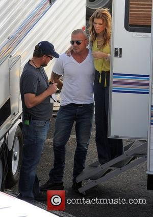AnnaLynne McCord cuddles boyfriend Dominic Purcell on the set of '90210' in Malibu Los Angeles, California - 02.02.12