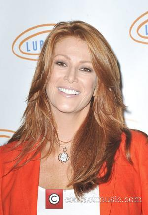 Angie Everhart Reveals That She Has Thyroid Cancer