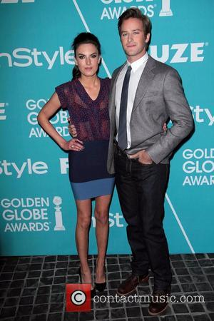 Armie Hammer (R) Elizabeth Chambers The Hollywood Foreign Press Association (HFPA) and InStyle present A Night Of Firsts held at...