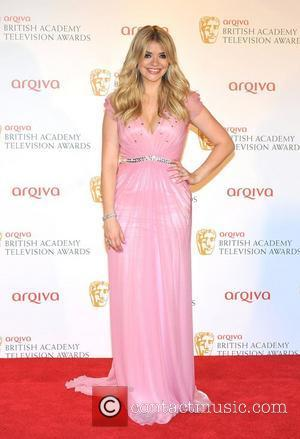 Awkward! Holly Willoughby Flashes Pants At Bafta Awards