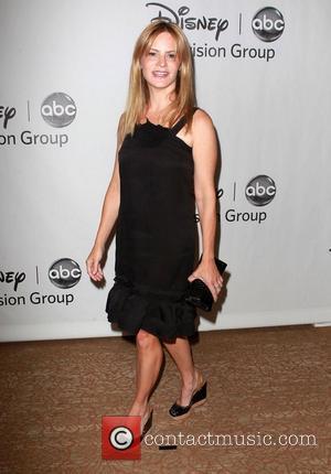 Jennifer Jason Leigh and Beverly Hilton Hotel