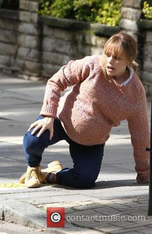 Rachel McAdams films a scene where she goes into labour on the famous Abbey Road zebra crossing  on the...