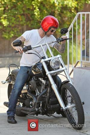 Adam Levine and girlfriend Behati Prinsloo  is photographed riding on his motorcycle after having lunch at Mustard Seed Cafe...