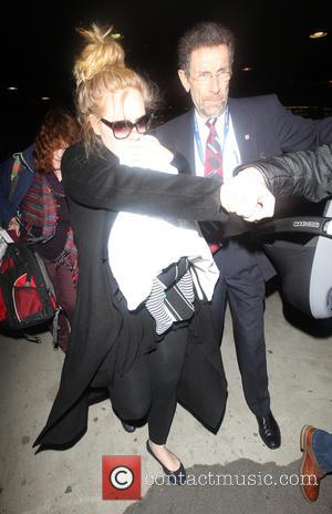 Adele Carries Baby Son, 3 Months, Through Lax Airport (Video)
