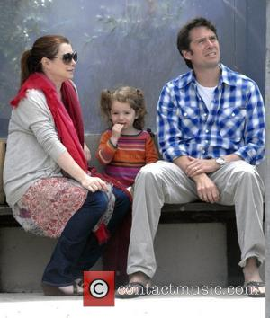 Alyson Hannigan and her husband Alexis Denisof sit with their daughter Satyana whilst out and about in Venice Los Angeles,...