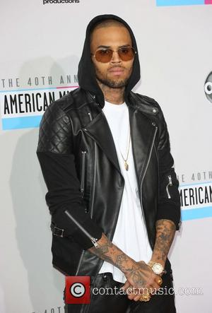 Chris Brown Returns To Twitter With Intimate Rihanna Photographs