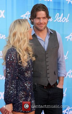 Carrie Underwood and Guest 'American Idol' Season 11 grand finale show held at Nokia Theatre L.A. Live - Arrivals Los...