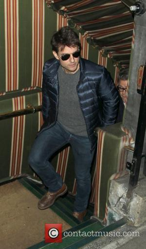 Tom Cruise Dines With Mystery Woman