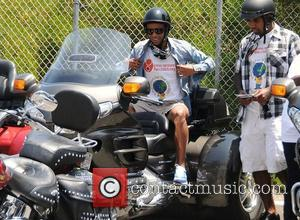 Ashley Cole Professional football players from the English Premier League host an event at Eaglerider Motorcycles in support of 'armsaroundthechild.org'...