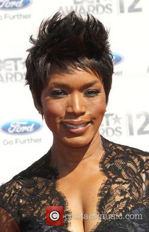 Angela Bassett To Play Coretta Scott King