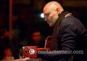 Billy Corgan Rings In 46th Birthday Onstage