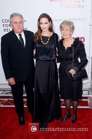 Angelina Jolie with Brad Pitt's parents, William Pitt and Jane Pitt Premiere of 'In the Land of Blood and Honey'...