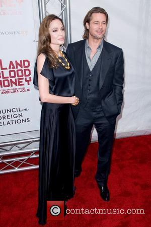 Angelina Jolie and Brad Pitt Premiere of 'In the Land of Blood and Honey' at the School of Visual Arts...