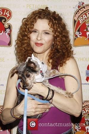 Bernadette Peters holds Woody, a dog up for adoption Broadway Barks: The 14th Annual Dog and Cat Adopt-a-thon held in...