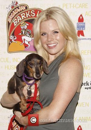 Megan Hilty holds April, a dog up for adoption Broadway Barks: The 14th Annual Dog and Cat Adopt-a-thon held in...