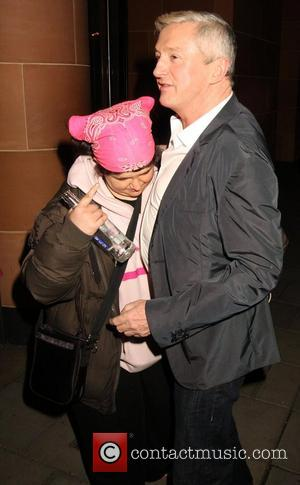 Louis Walsh and celebrity hugger Tanya Macintosh 'The X Factor' judges outside C London restaurant, after earlier appearing on the...