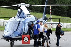 Carrie Underwood  arriving at the 1st Annual 'Boots and Hearts Music Festiva' l by private helicopter.  Bowmanville, Canada...
