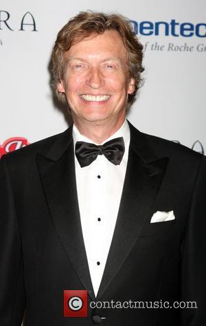 Axe Continues To Swing As Producers Nigel Lythgoe And Ken Warwick Leave 'American Idol'