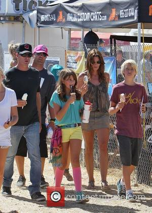 Cindy Crawford eating an ice cream with husband Rande Gerber daughter Kaia Jordan Gerber at the 31st Annual Malibu Kiwanis...